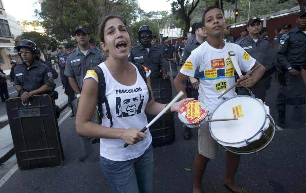 Wearing a T-shirt showing Rio de Janeiro`s Governor Sergio Cabral under a writing that reads in Portuguese