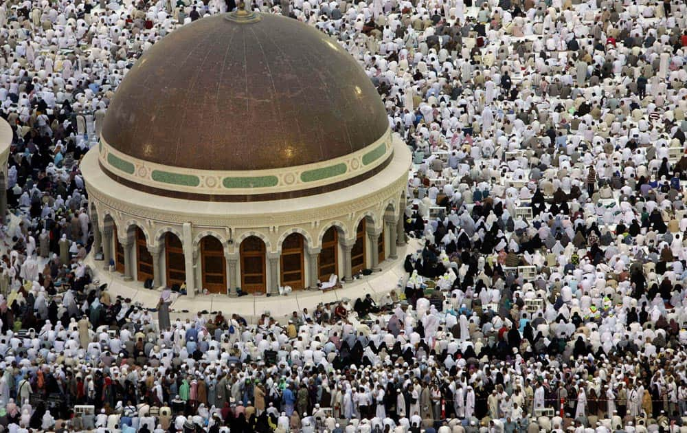 Muslim pilgrims prepare to offer prayers at sunset at the Grand Mosque in the Muslim holy city of Mecca, Saudi Arabia.