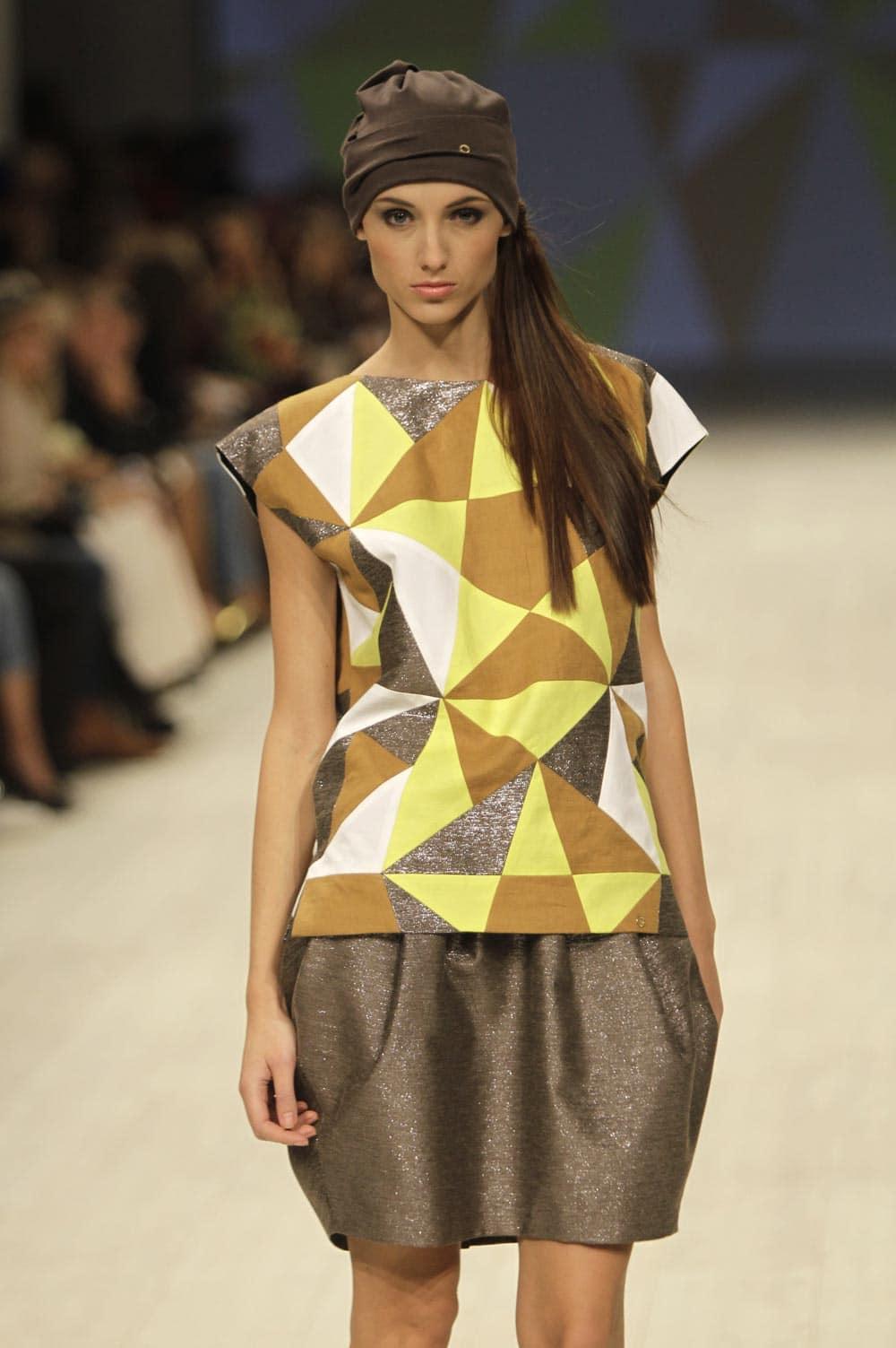 A model displays an outfit by Ukrainian designer Anna Bublik during a Fashion Week in Kiev, Ukraine.