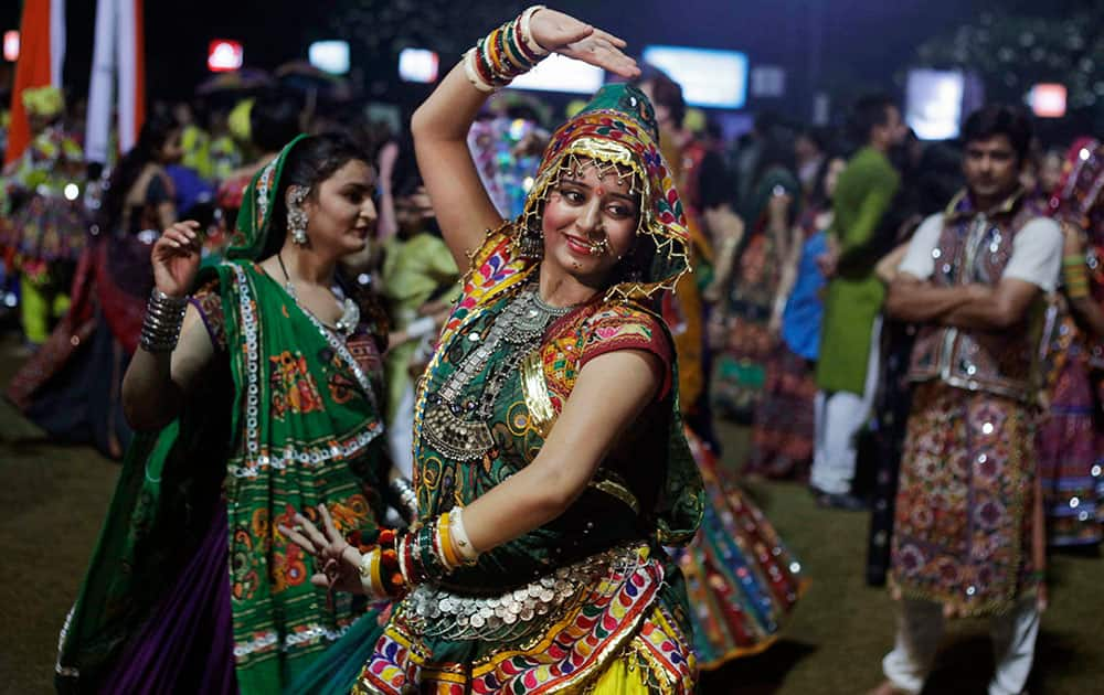 A woman dressed in traditional finery performs the Garba dance of the Navratri festival in Ahmadabad.