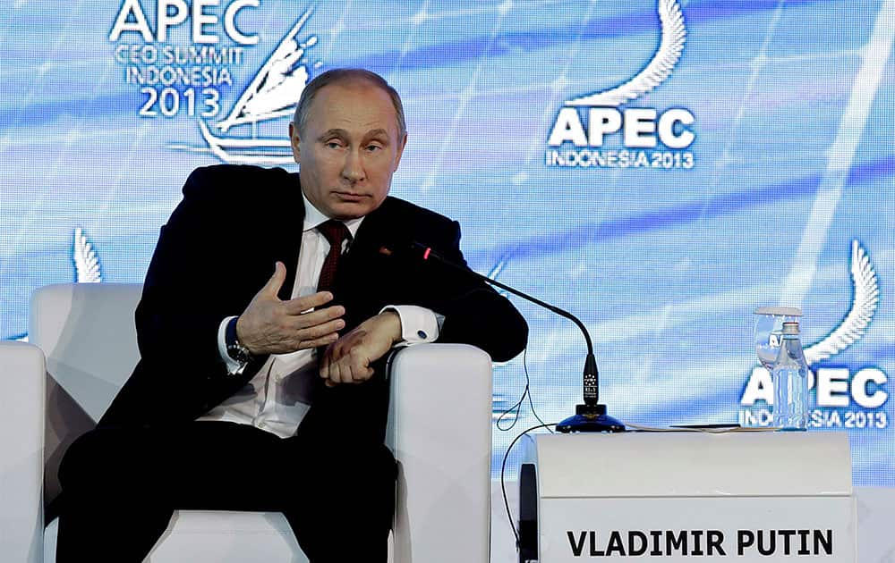 Russian President Vladimir Putin delivers his keynote address at the Asia-Pacific Economic Cooperation CEO Summit in Bali, Indonesia.