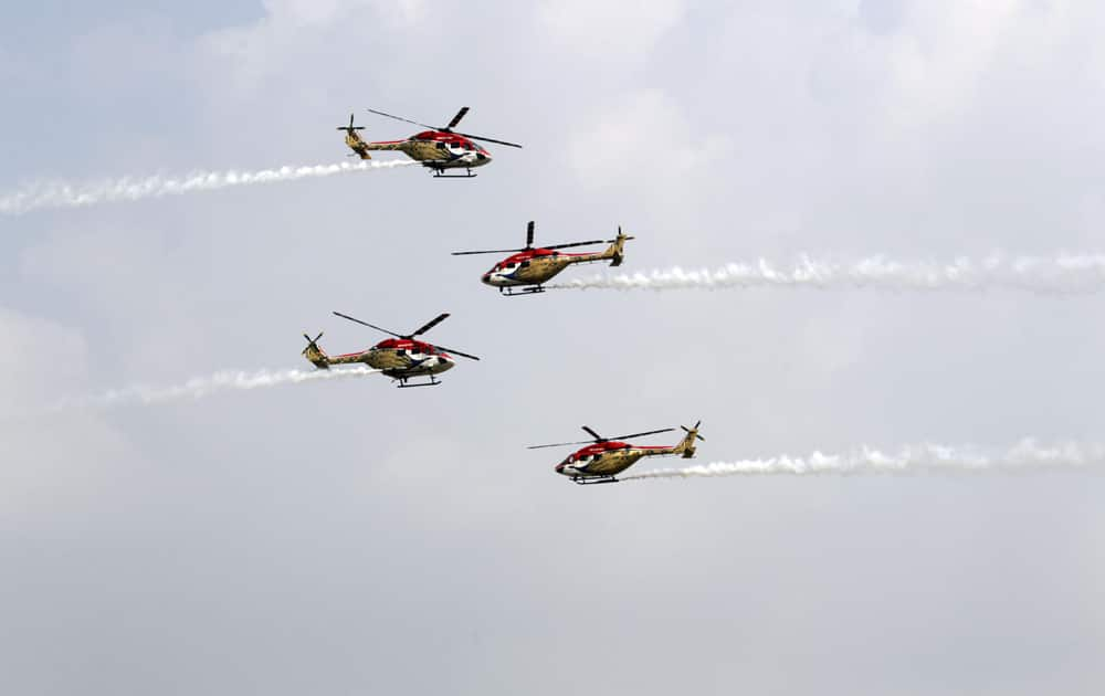 Indian Air Force (IAF) Sarang helicopters perform a display during parade rehearsals ahead of Air Force Day at Hindon, on the outskirts of New Delhi.