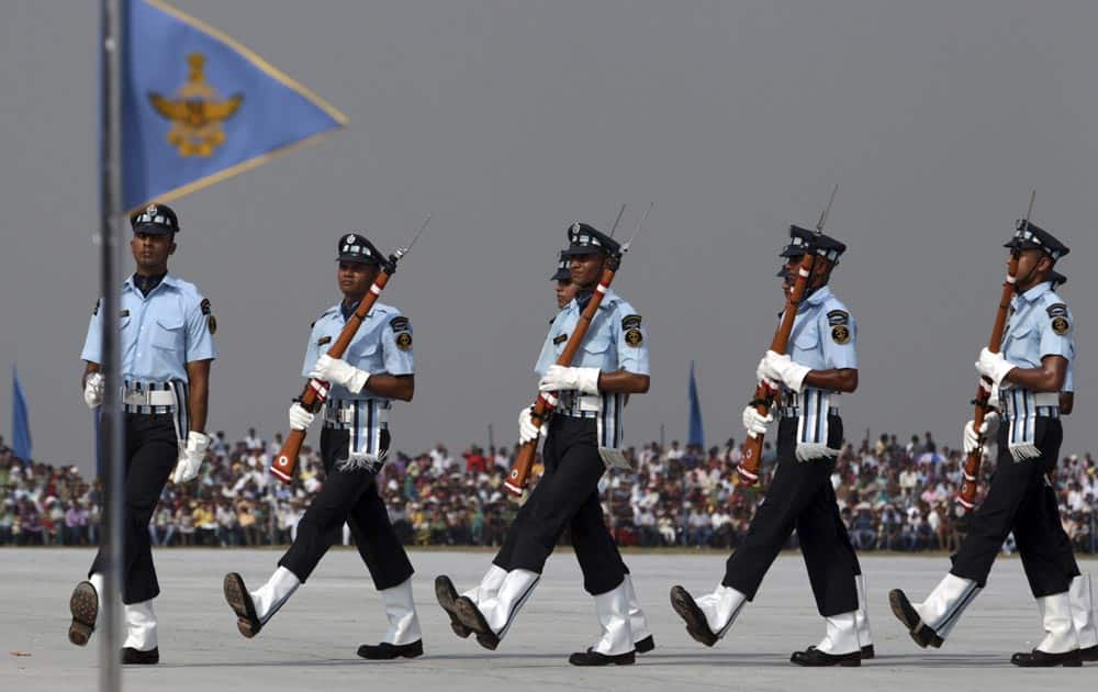 Indian Air Force (IAF) Air Warrior drill team display skills during parade rehearsals ahead of Air Force Day at Hindon, on the outskirts of New Delhi.