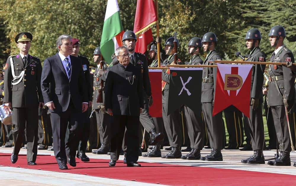 President Pranab Mukherjee and his Turkish counterpart Abdullah Gul, inspect the military honor guard during a ceremony at the Cankaya Palace in Ankara, Turkey.