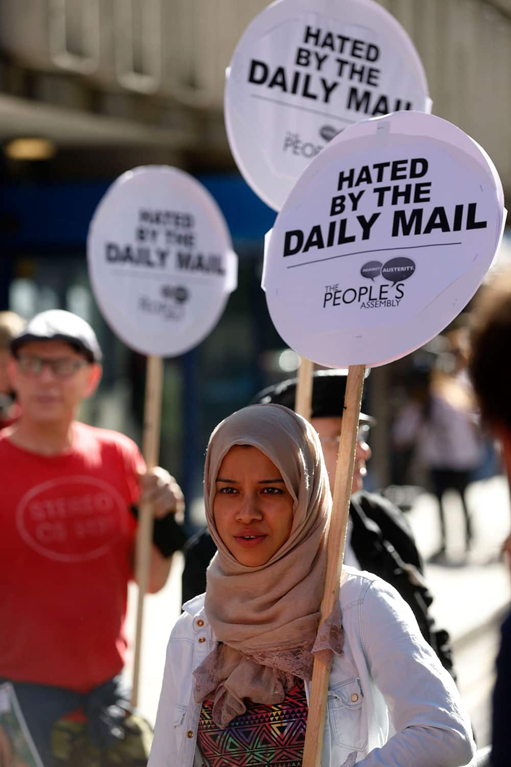 A woman displays a placard, during a `Daily Mail Hates Britain` protest, organised by the People`s Asssembly, outside the Daily Mail newspaper headquarters, in London.