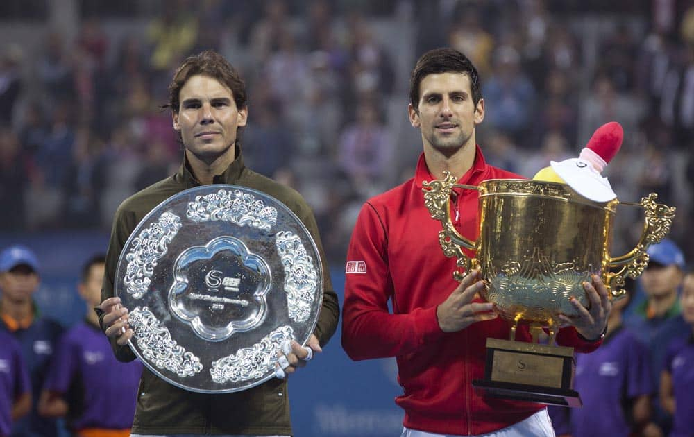 Novak Djokovic of Serbia and Rafael Nadal of Spain pose with their trophies after the final of the China Open tennis tournament at the National Tennis Stadium in Beijing, China.