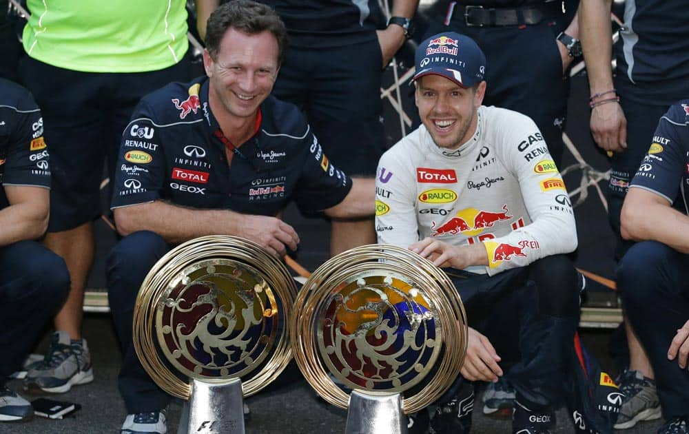 Red Bull driver Sebastian Vettel, right, of Germany and team principle Christian Horner pose for a photo after Vettel`s win in the Korean Formula One Grand Prix at the Korean International Circuit in Yeongam, South Korea.