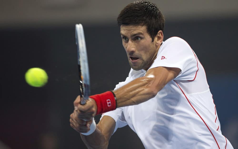 Novak Djokovic of Serbia returns a shot to Richard Gasquet of France during the semifinal match of the China Open tennis tournament at the National Tennis Stadium, in Beijing, China.