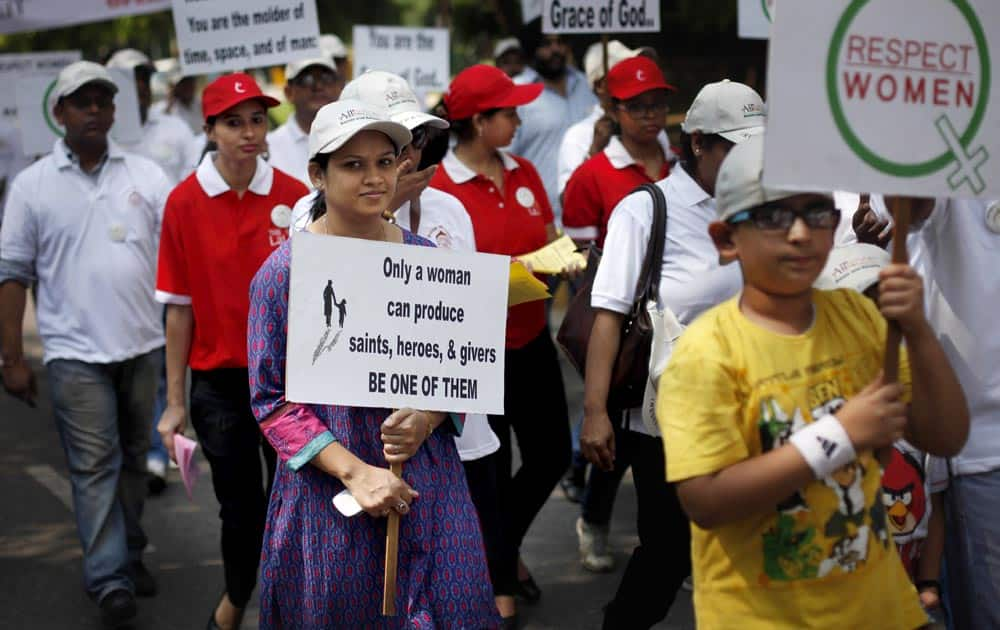 "People march during ""I Respect Women"" walk for gender equality organized by a local hotel and Association of Domestic Tour Operators of India in New Delhi."
