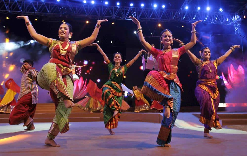 Artists dressed in traditional attire rehearse for the inauguration function of Navratri festival in Ahmedabad.