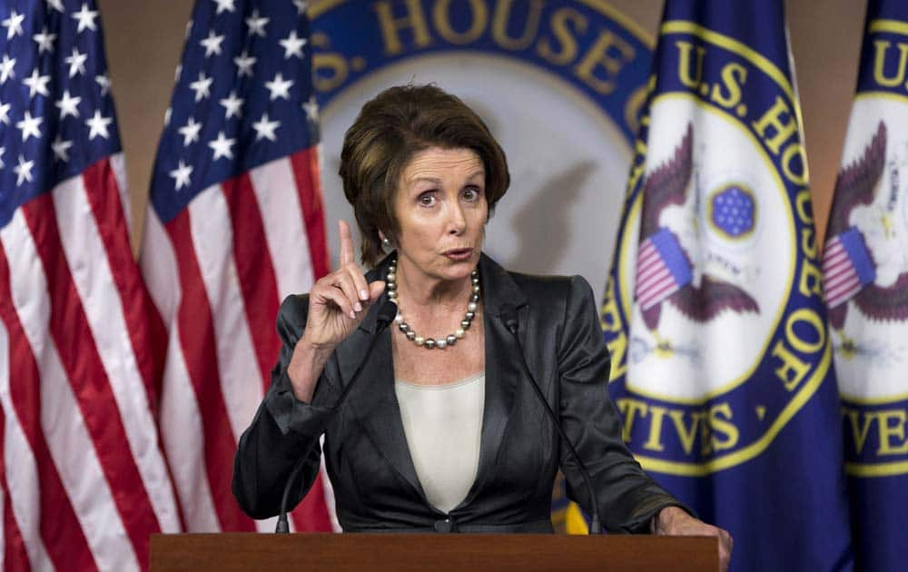 House Minority Leader Nancy Pelosi of Calif. gestures during a news conference about the ongoing budget fight, on Capitol Hill in Washington.