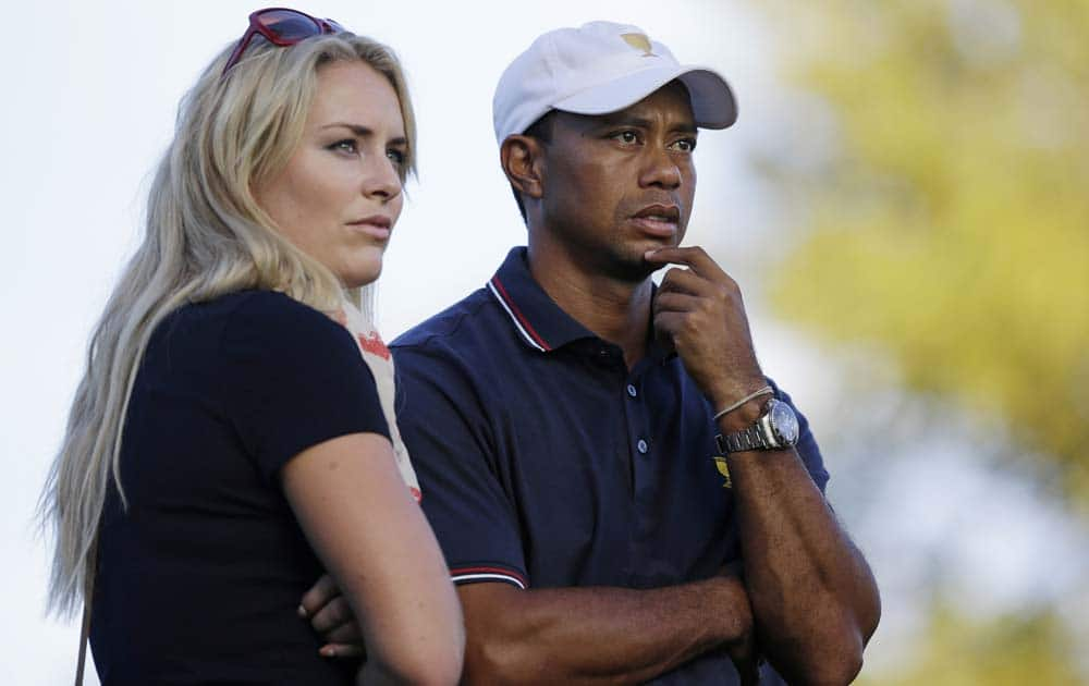 United States, Tiger Woods watches the 17th hole with his girlfriend Lindsey Vonn during the four-ball matches at the Presidents Cup golf tournament at Muirfield Village Golf Club, in Dublin.