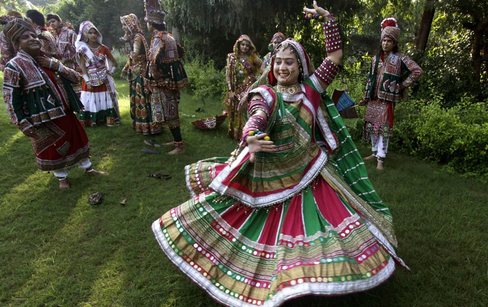 People dressed in traditional attire practice Garba, a form of dance from Gujarat , to celebrate the upcoming festival of Navratri, in Ahmadabad.