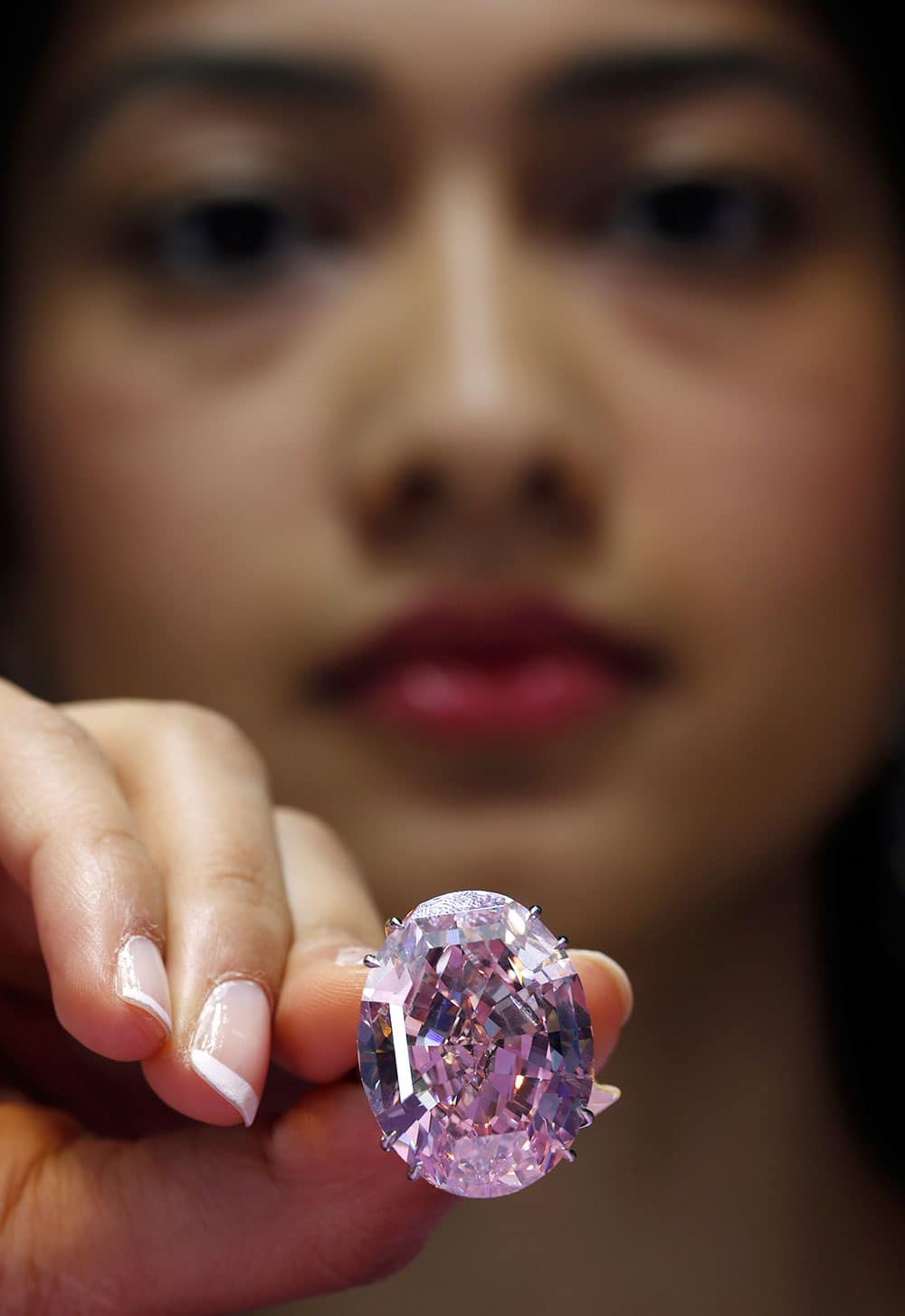 The Pink Star diamond weighing 59.6 carat is displayed during a press preview at Sotheby`s, in Hong Kong. he Pink Star, one of the world`s natural treasures, is the most valuable diamond ever to be offered at auction, estimated in excess of US$ 60 million.
