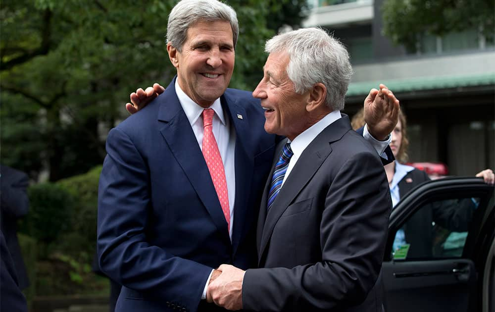 US Secretary of State John Kerry and US Secretary of Defense Chuck Hagel greet each other before attending a wreath laying ceremony at Chidorigafuchi National Cemetery in Tokyo.