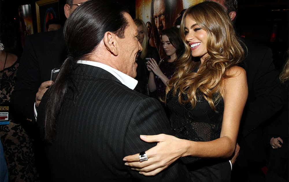 Sofia Vergara, right, and Danny Trejo pose together on the red carpet of the premiere of