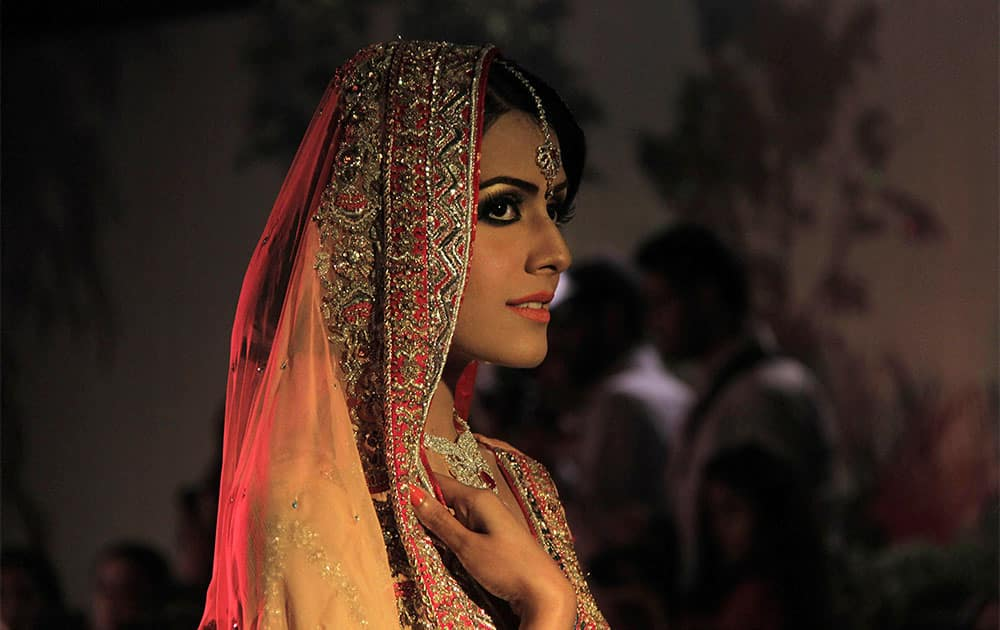 A Pakistani model presents a creation from the Saba Gul`s bridal collection, in Peshawar, Pakistan.