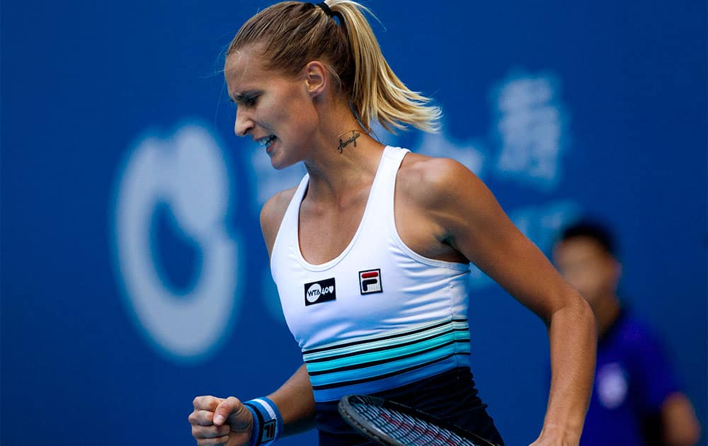 Polona Hercog of Slovenia reacts to a point she won against Ana Ivanovic of Serbia during the China Open tennis tournament.