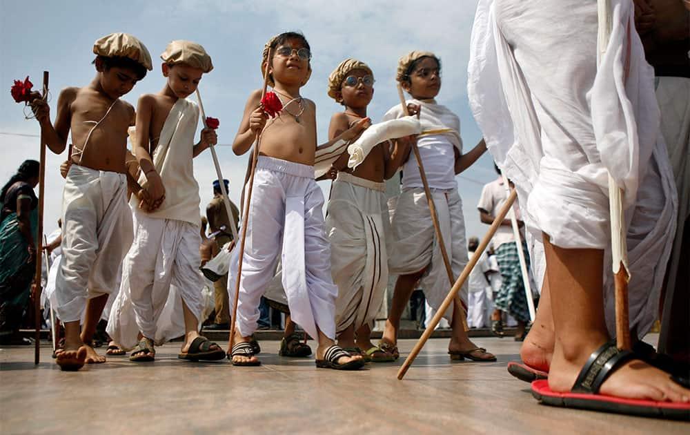 Children dressed as Mahatma Gandhi assemble at an event to mark Gandhi's birth anniversary in Chennai.