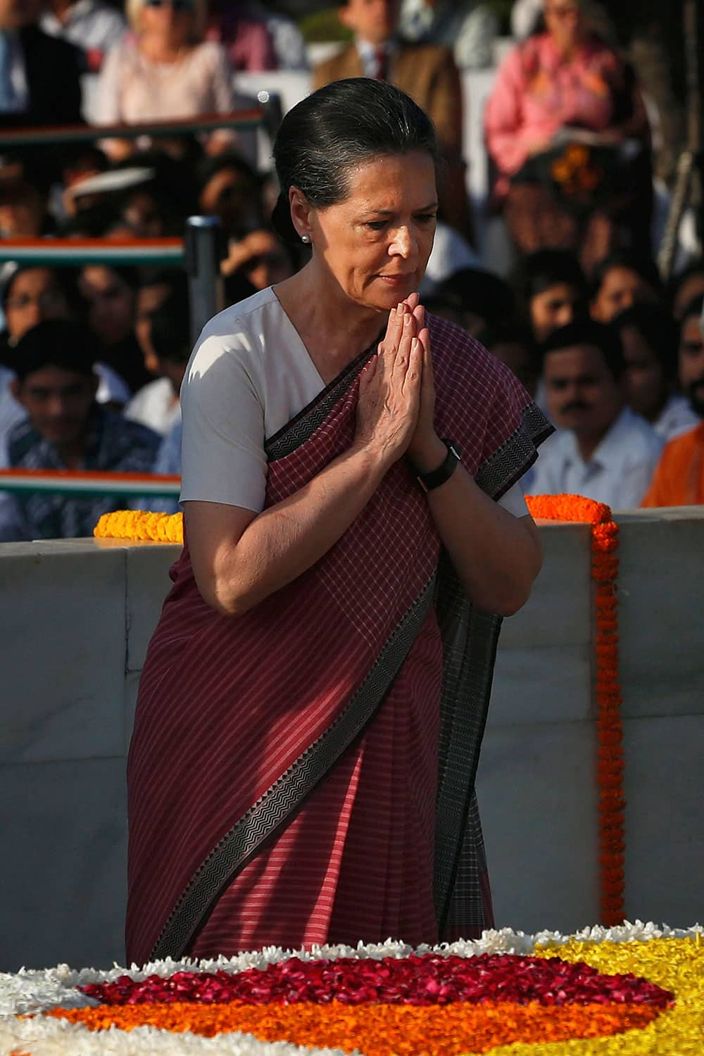 Congress Party President Sonia Gandhi offers prayers at a memorial of Mahatma Gandhi on the occasion of his birth anniversary, in New Delhi.