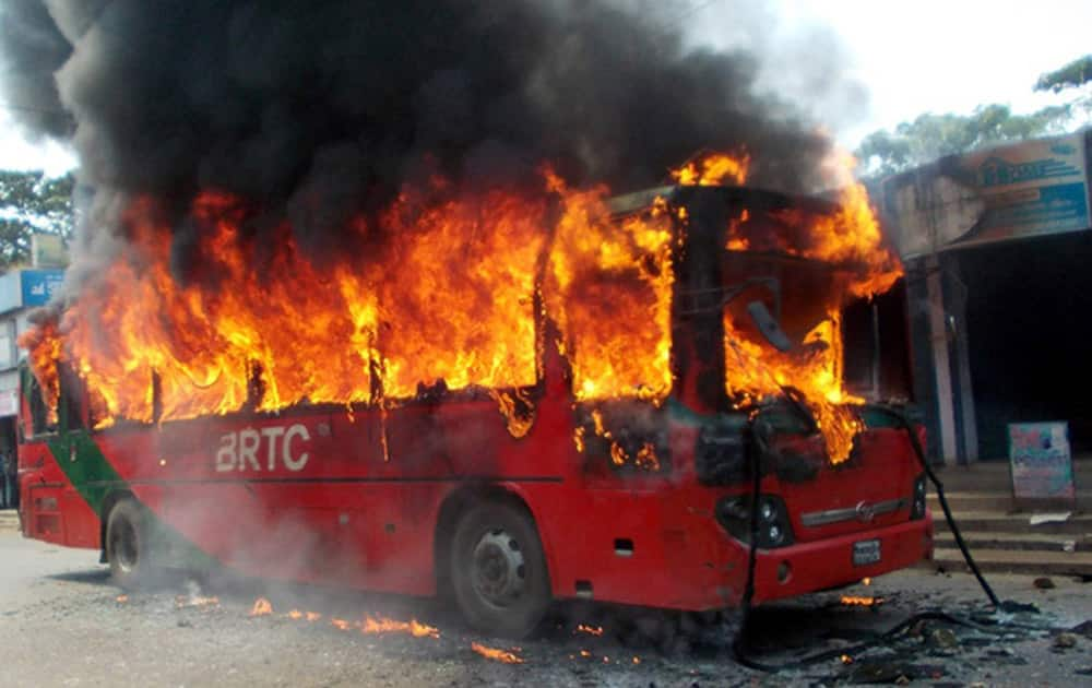 A bus stands in flames after it was set on fire by activists of the opposition Bangladesh Nationalist Party (BNP) to protest against the death sentence awarded to their leader Salauddin Quader Chowdhury in Chittagong, Bangladesh.