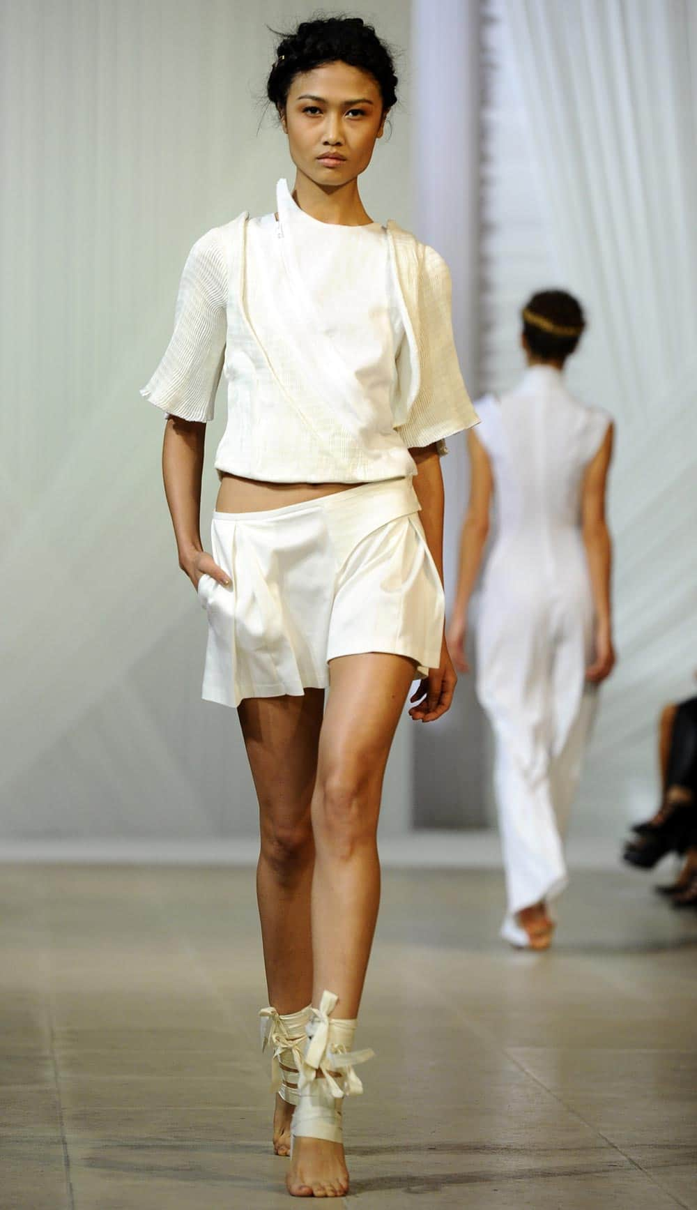 A model presents a creation for Fatima Lopes` ready-to-wear Spring/Summer 2014 fashion collection presented in Paris.