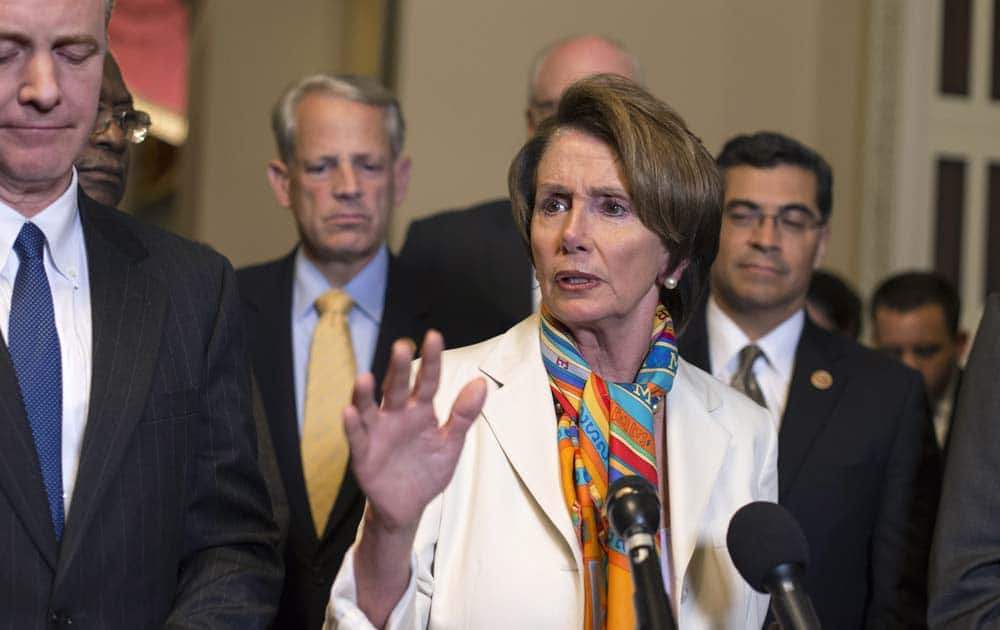 House Minority Leader Nancy Pelosi, D-Calif., center, and House Democratic leaders speak to reporters just before midnight at the Capitol in Washington.