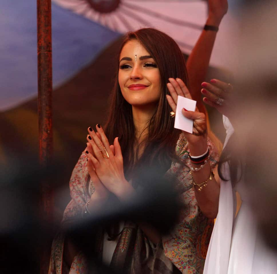 Miss Universe Olivia Culpo applauds inmates during a visit to the Tihar Jail in New Delhi.
