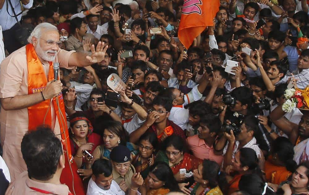 Bharatiya Janata party leader Narendra Modi waves to supporters as he arrives to address a public rally in Mumbai.