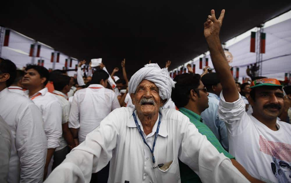 An elderly man listens to a speaker at a political rally in New Delhi.