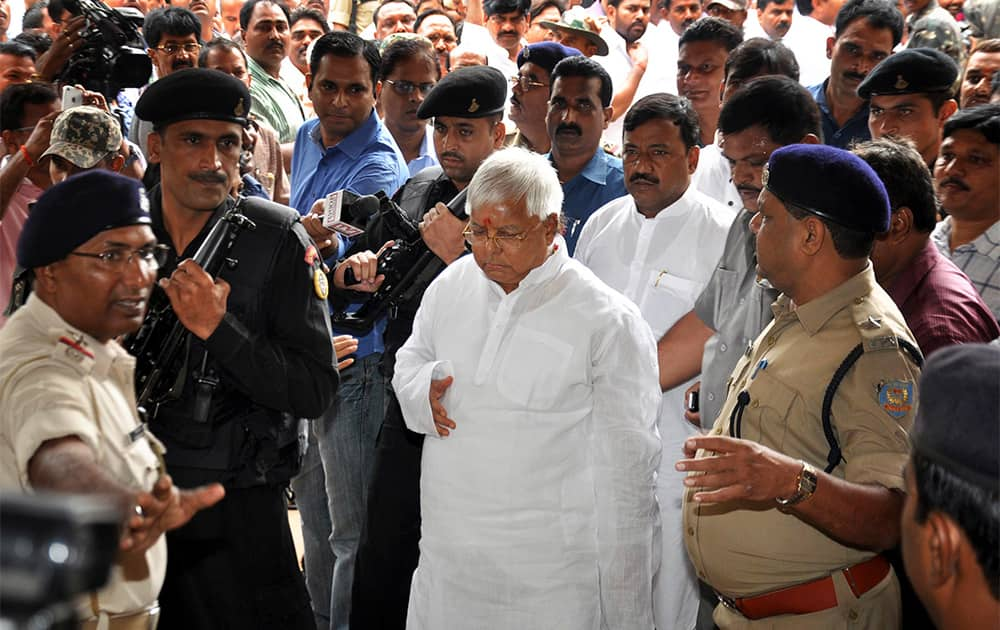 Leader of Rashtriya Janata Dal, Lalu Prasad Yadav arrives at a special court held by Central Bureau of Investigation (CBI) for a verdict on fraudulent transfer of public money, in Ranchi.