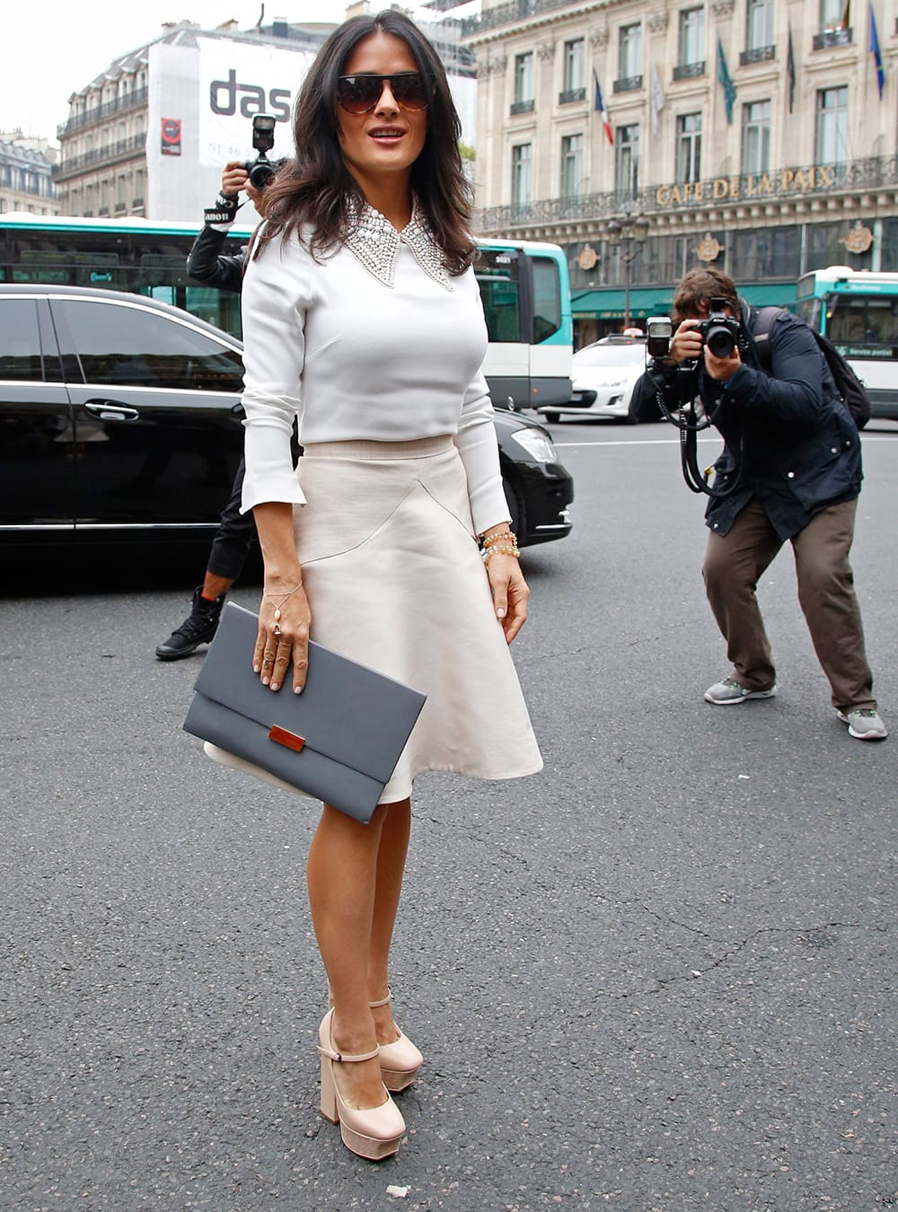 Salma Hayek arrives to attend Stella McCartney`s ready-to-wear Spring/Summer 2014 fashion collection.