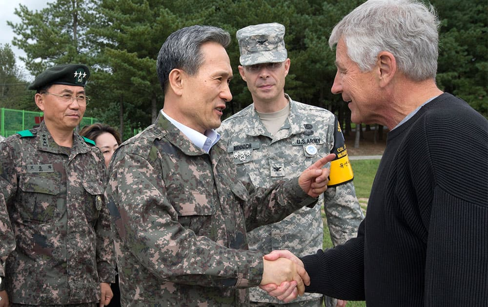 US Secretary of Defense Chuck Hagel, right, is greeted by South Korean Defense Minister Kim Kwan-jin, before a tour of the Demilitarized Zone (DMZ), the military border separating the two Koreas, in Panmunjom, South Korea.