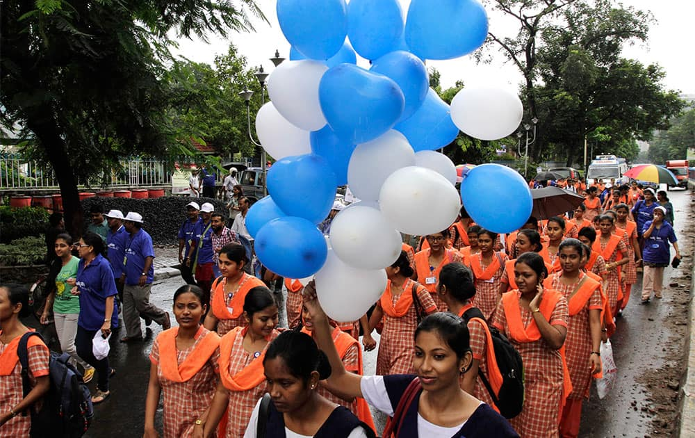 Paramedics, students and others join an awareness rally to fight against cardiovascular disease on World Heart Day in Kolkata.