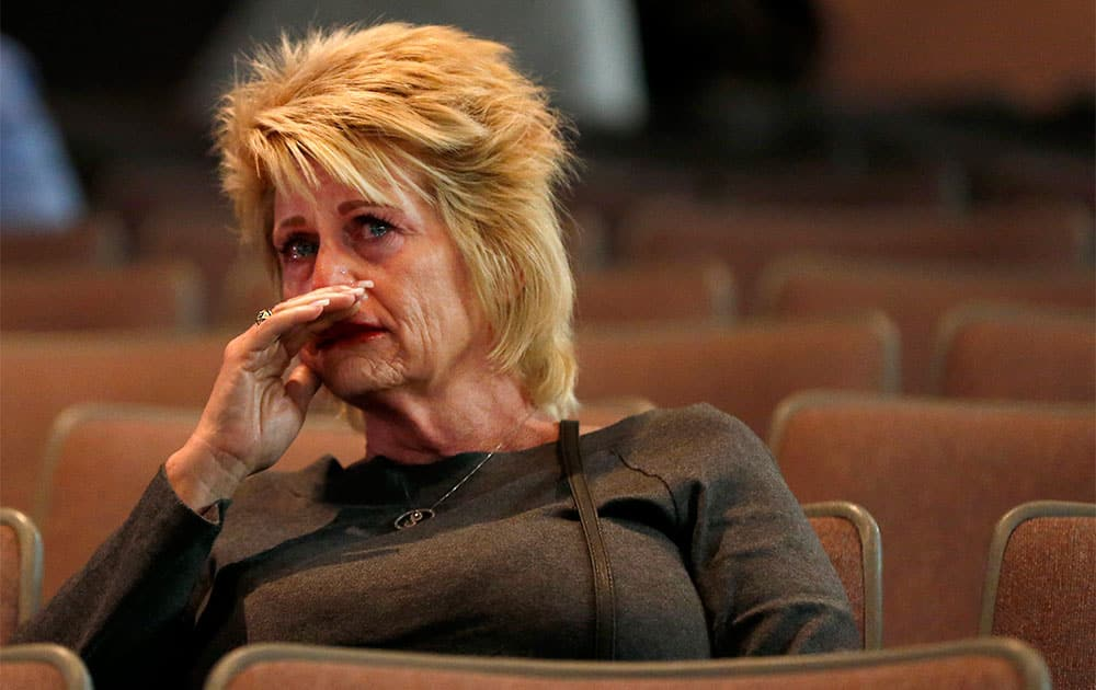 A tearful Shari Turbyfill, step mom to Travis Turbyfill who died fighting the Yarnell wildfire, listens to a panel announce their findings as the official report is released Saturday, Sept. 28, 2013, examining to explain how 19 members of an elite firefighting crew died while battling the Arizona wildfire, in Prescott, Ariz.