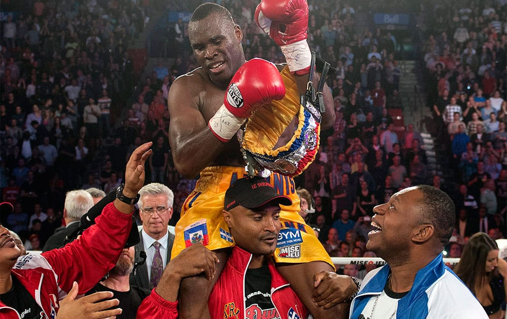Adonis Stevenson, from Montreal, celebrates after defeating Tavoris Cloud to defend his light heavyweight title in a boxing bout Saturday, Sept. 28, 2013, in Montreal.