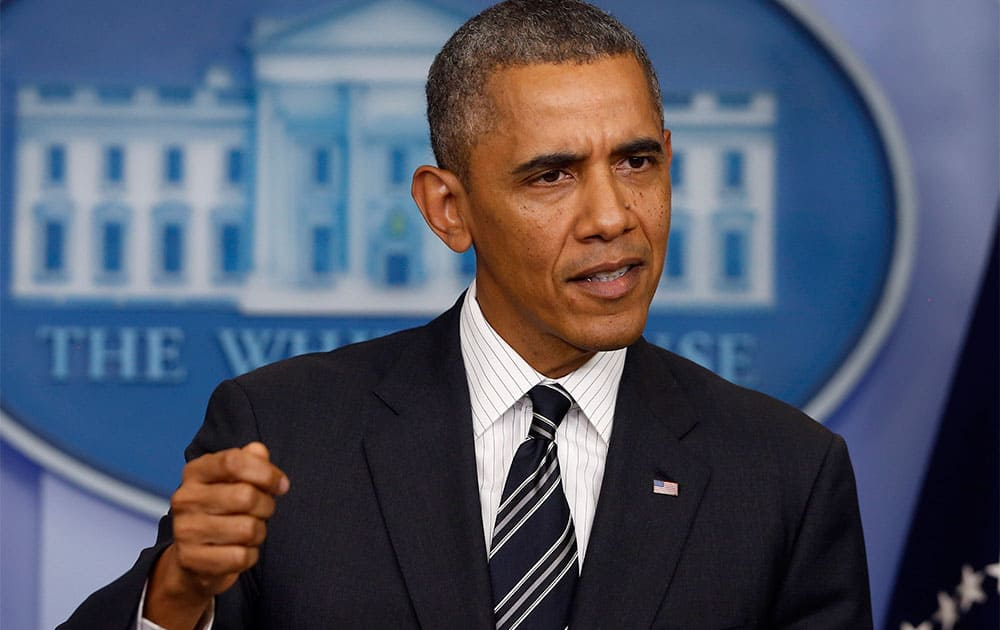 President Barack Obama gestures while making a statement regarding the budget fight in Congress and foreign policy challenges, in the James Brady Press Briefing Room of the White House in Washington.