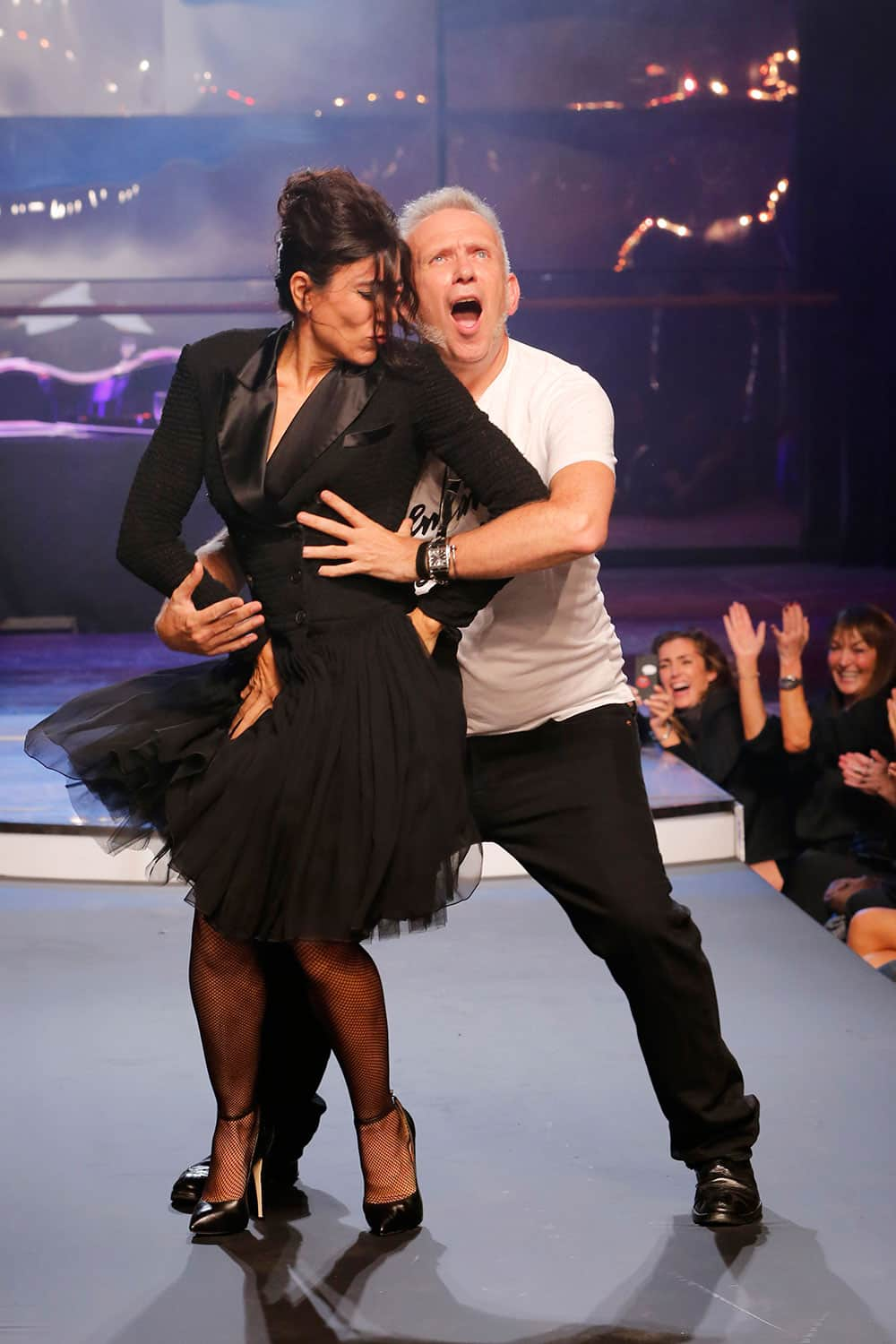 Fashion designer Jean-Paul Gaultier, right, and choreographer Blanca Li perform a dance, following the presentation of Gaultier`s ready-to-wear Spring/Summer 2014 fashion collection.
