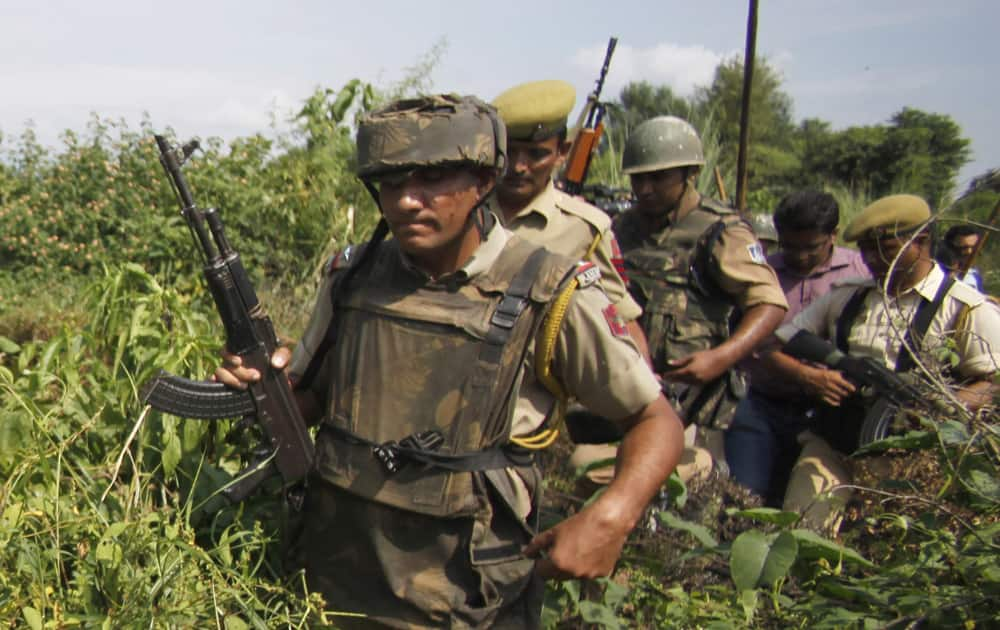 Indian policemen patrol the Chajarth forest area in Kathua, about 60 kilometers (38 miles) from Jammu. Security forces have launched a massive search operation in the area after villagers claimed they sighted terrorists.