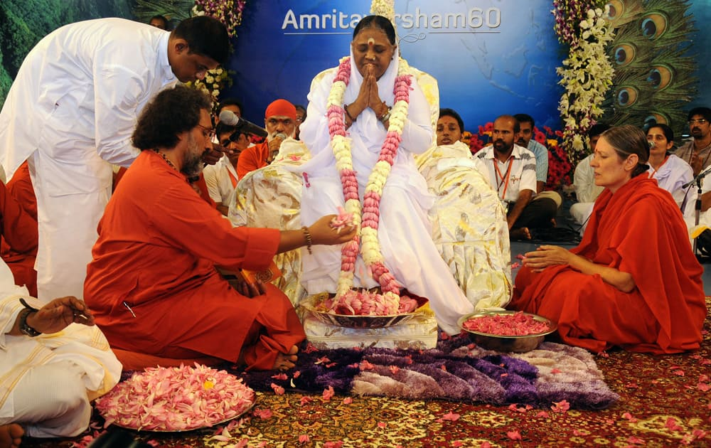 Spiritual leader Mata Amritanandamayi attends celebrations marking her 60th birthday at Vallikavu, near Kollam, Kerala.