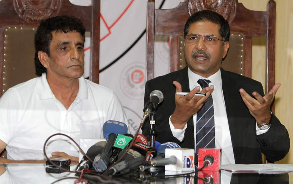 Pakistani cricket umpire Asad Rauf and his lawyer Syed Ali Zafar address a news conference in Lahore. Zafar says Rauf will not be appearing in Indian court over spot-fixing charges as he has no confidence in Mumbai police, who framed charges against the Pakistani umpire.