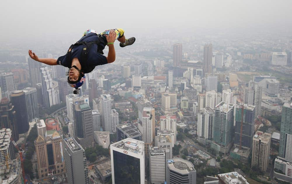 Base jumper Vincent Philippe Benjamin Reffet of France leaps from the 300-meter Open Deck of the Malaysia`s landmark, Kuala Lumpur Tower during the International Tower Jump.