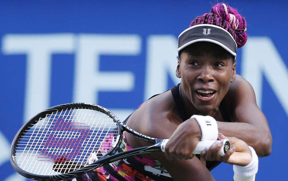 Venus Williams of the United States returns the ball against Petra Kvitova of the Czech Republic during their semi-final match of the Pan Pacific Open tennis tournament in Tokyo.