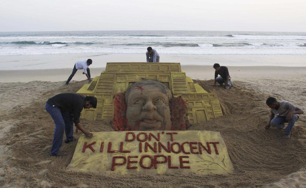 Sudarshan Pattnaik and his team pay tributes to the victims of the terror attack on a Kenya mall by creating a sand sculpture on the Bay of Bengal coast in Puri, Orissa.