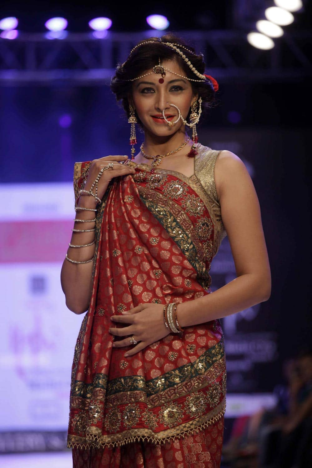 A model displays a creation by Palak`s Couture during India Jewelery and Fashion Week in Ahmedabad.