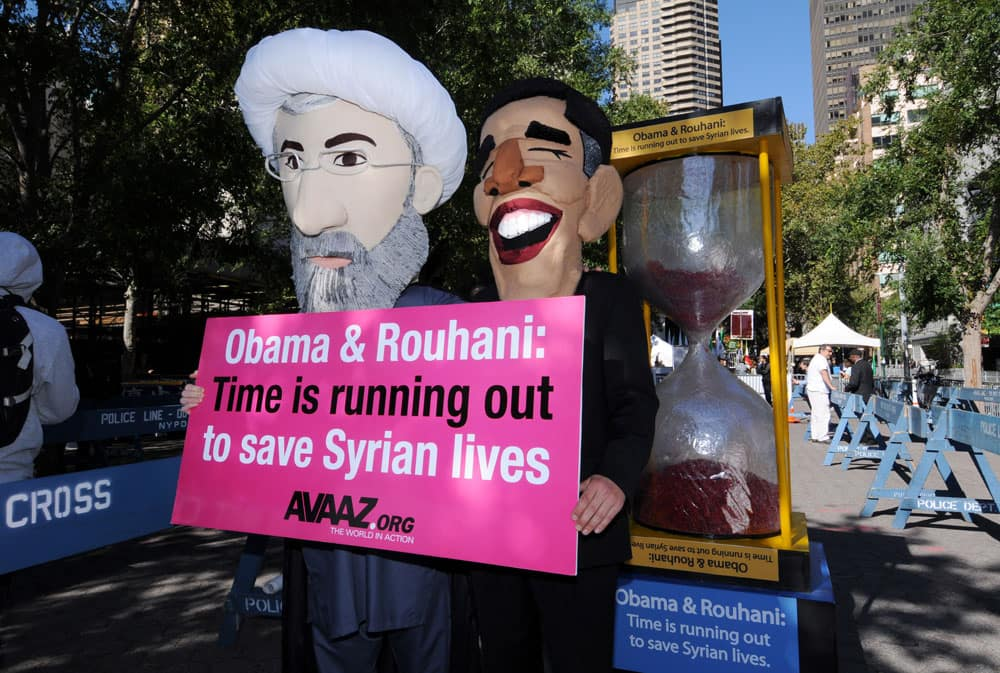 Campaigners from the global advocacy group Avaaz, dressed as Presidents Obama and Rouhani, demand the two leaders negotiate a ceasefire to the Syrian crisis during the United Nations General Assembly.