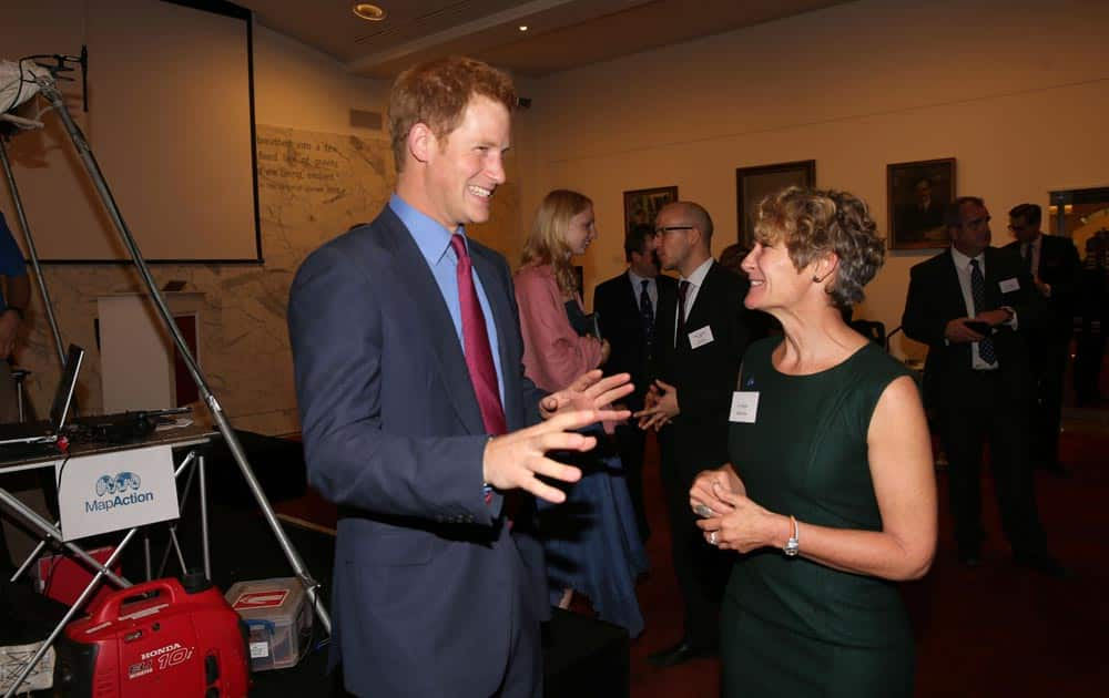 Britain`s Prince Harry, with Chief Executive, Liz Hughes, at a reception for MapAction at the Royal Society, in central London.