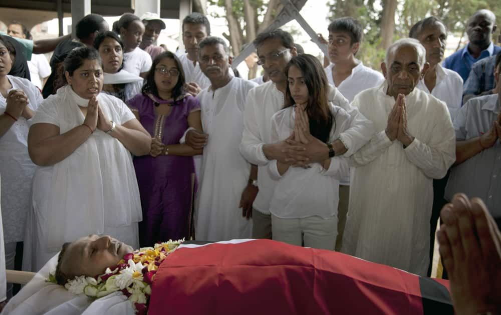 Family members pay their last respect to late Mitul Amritlal Shah, of Bidco Group of Kenya, who was shot dead in the attack on the Westgate Mall, at his funeral at the Hindu Crematorium in Nairobi, Kenya.
