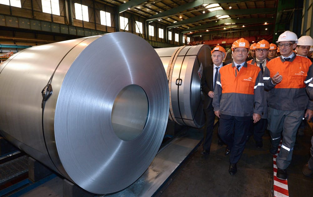 French President Francois Hollande visits with unidentified Arcelor Mittal executives, the steel factory Arcelor-Mittal in Florange, eastern France.