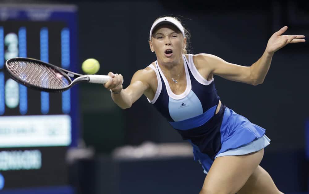 Caroline Wozniacki of Denmark returns the ball against Lucie Safarova of the Czech Republic during their quarterfinal match of the Pan Pacific Open tennis tournament in Tokyo.